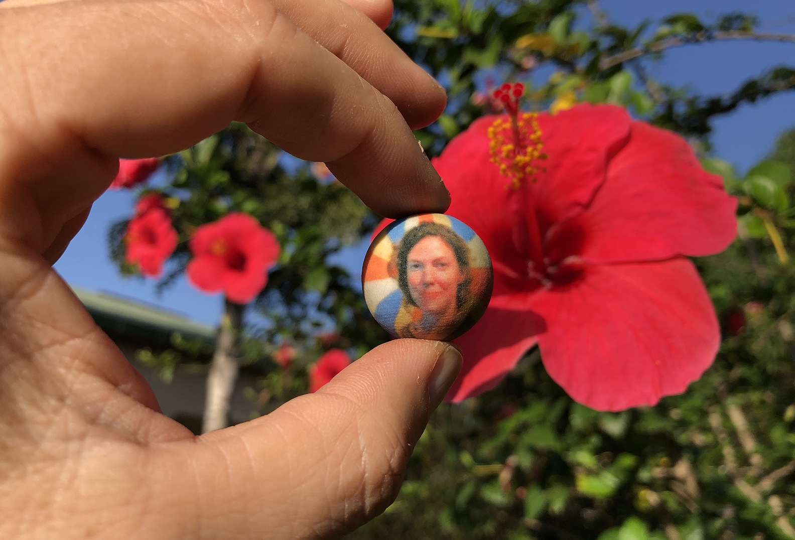 A tiny sphere containing Beth's ashes
